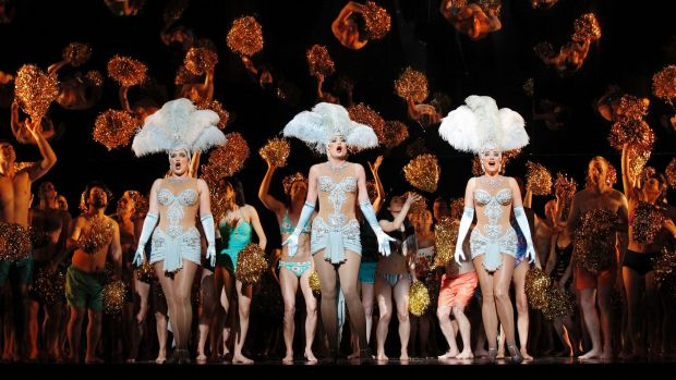 Dominica Matthews, Jane Ede and Lorina Gore as the Rhinemaidens amid the Sea of Humanity in  <i>Das Rheingold</i>.