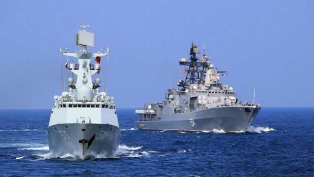 A Chinese Navy frigate and a Russian Navy ship take part in a joint naval drill in the South China Sea.