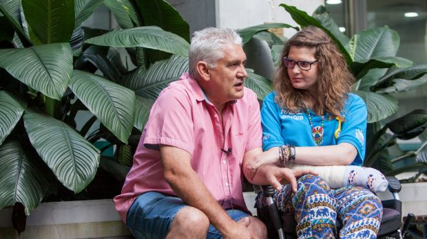 A PARTY Program speaker, Peter de Wet, with his daughter Charmaine, 21, who narrowly survived a car accident when she was 17.