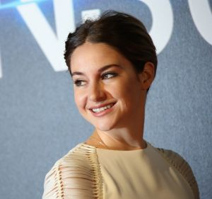 Actress Shailene Woodley poses for photographers upon arrival at a central London cinema for the world premiere of ...