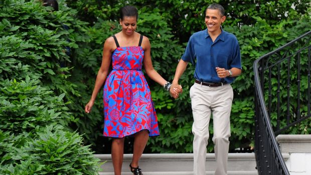 Michelle Obama walks with Barack Obama wearing Sophie Theallet at an Independence Day barbeque on the South Lawn of the ...