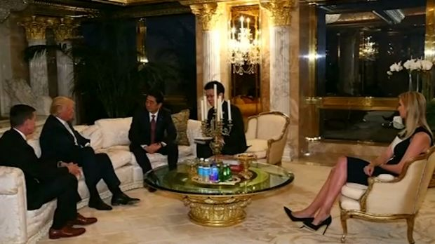 Japanese Prime Minister Shinzo Abe, third from left, meets with Donald Trump, second from left, at Trump Tower on ...