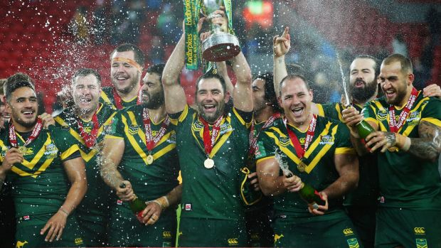 Cameron Smith lifts the trophy with team mates after victory in the Four Nations Final.