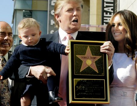 Donald Trump with his wife, Melania, and their son, Barron, pose for a photo after he was given a star on the Hollywood ...