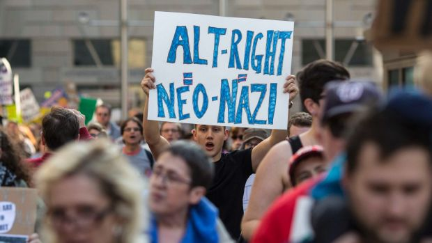 Protesters march outside a conference of the so-called alt-right in Washington.