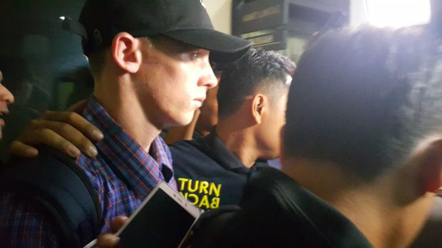 Jamie Murphy leaves Kuta police station after his release.
