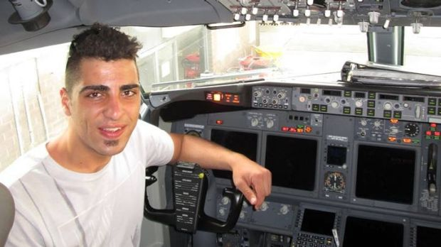 Paul Sant poses in a cockpit.