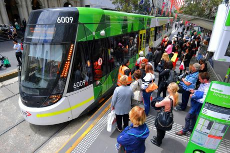 Crowded tram stop at the Bourke Street mall.