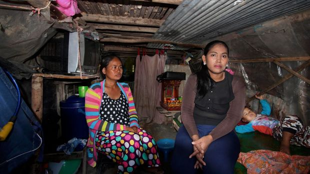 Hour Vanny, left, who gave birth to a baby for an Australian man, with her sister-in-law Som Tha Satry, who gave birth ...