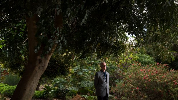 Trevor Pitkin in the north-west corner of Melbourne University's 160-year-old system garden, which is set to make way ...
