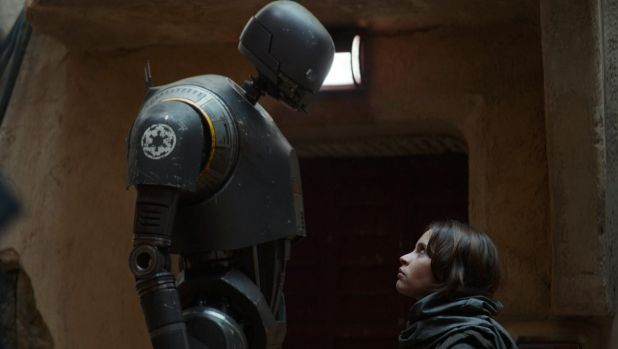 Robot K-2SO (left, with Felicity Jones as Jyn Erso) is the undisputed star in the latest Star Wards installment. A sign ...