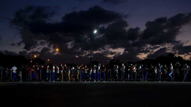 People wait in line at night to pay their final respects to the late Fidel Castro in the Revolution Plaza in Havana, Cuba.
