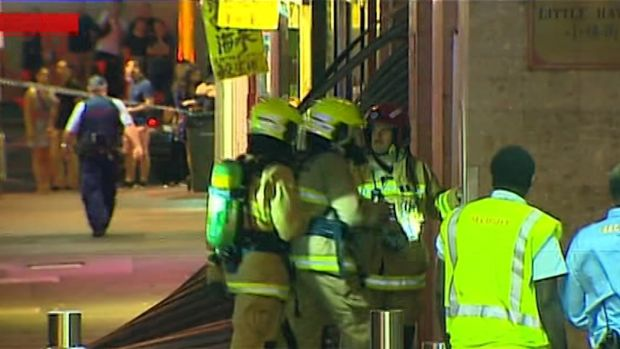 Firefighters enter the Dixon House shopping centre where a gas explosion struck on Tuesday night.