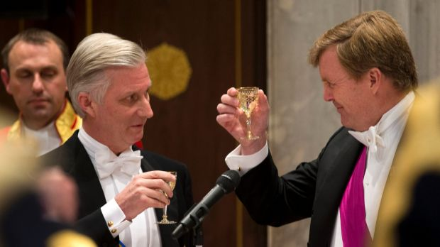 Celebrations: Dutch King Willem-Alexander, right, toasts with Belgian King Philippe at the royal palace in Amsterdam on ...