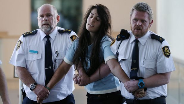 Protestors are escorted from Parliament House in Canberra on Wednesday.