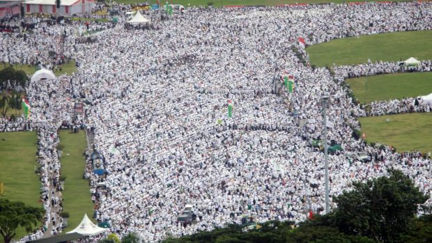 """Indonesian Muslims gather at the National Monument in Jakarta during a rally against governor Basuki """"Ahok"""" Tjahaja ..."""