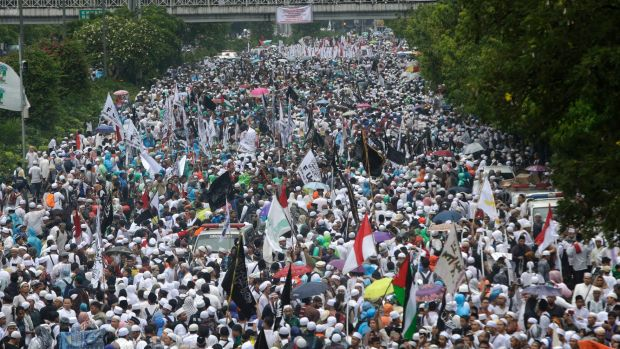 Indonesian Muslims march during a rally against Jakarta's minority Christian governor earlier this month.