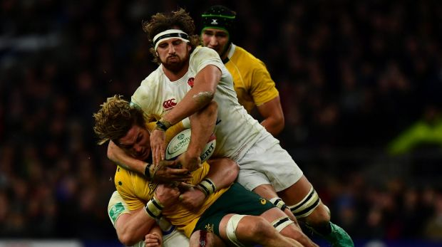 Michael Hooper of Australia (L) is tackled by Tom Wood of England (R) during the Old Mutual Wealth Series match between ...