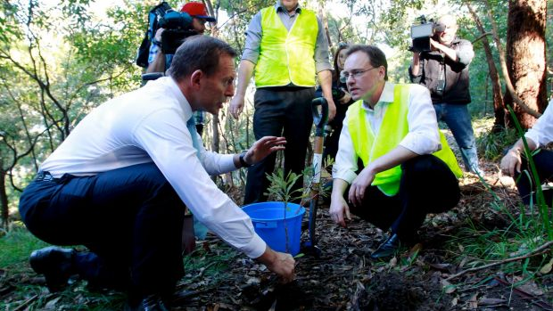 The Green Army was a signature environment policy when Tony Abbott (left) was prime minister, and Greg Hunt (right) his ...