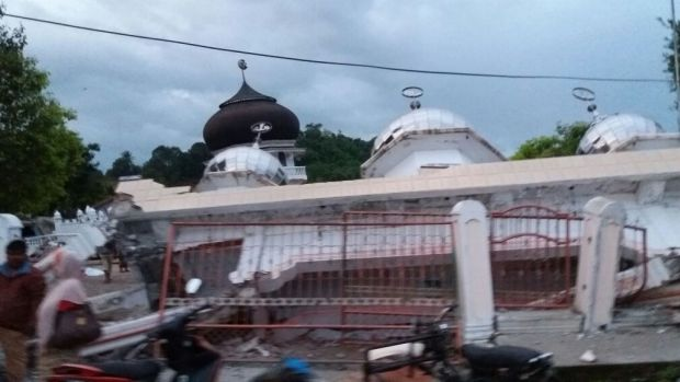 The National Agency for Disaster Management (BNPB) reported injuries and damage, including a crumpled mosque.
