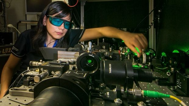 Rocio Camacho-Morales, a PhD candidate at the Australian National University. Here she adjusts the laser equipment in ...