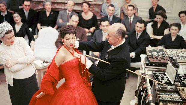 "Christian Dior with fashion model Victoire wearing the ""Zaire"" dress in 1957."
