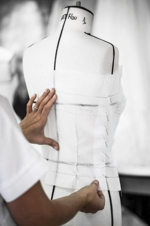 A pattern being fitted to a mannequin inside the ateliers of the House of Dior.