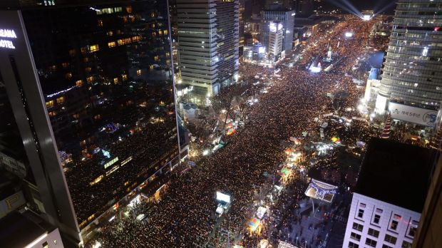 Masses of protesters occupy major streets in the centre of Seoul demanding South Korean President Park Geun-hye's ...