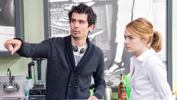 Director Damien Chazelle with Emma Stone on set.