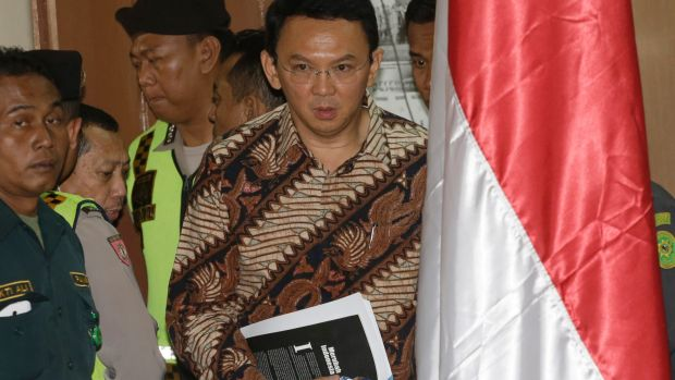 Ahok, centre, enters the courtroom on Tuesday.
