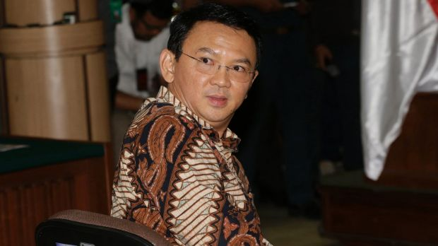 Jakarta governor Ahok, sits on the defendant's chair at the start of his trial.