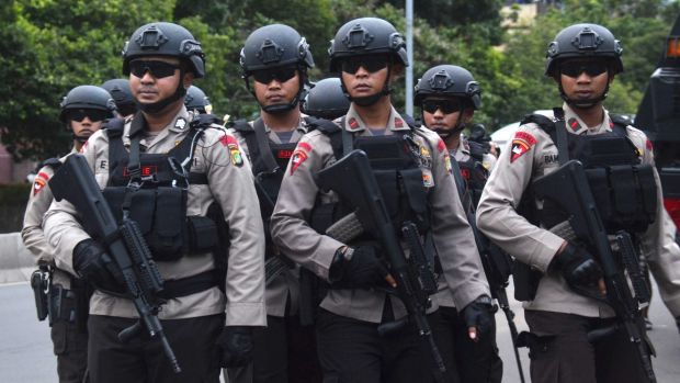 There was a heavy polcie presence ourside the court for day one of the trial of Jakarta governor Ahok.