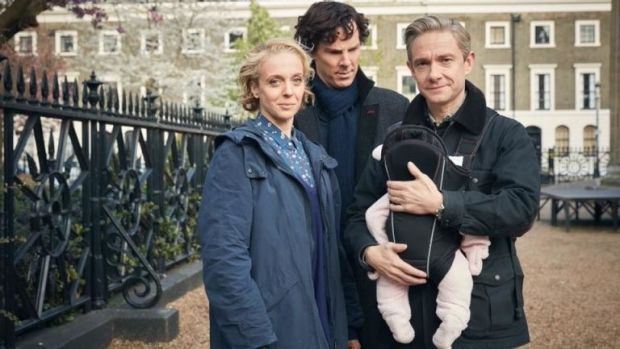 Happy families: The Watsons with their newest edition, and Sherlock looking so pleased for them.