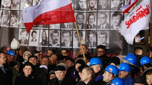 Law and Justice party leader Jaroslaw Kaczynski, centre, speaks during the 35th anniversary of the introduction of ...