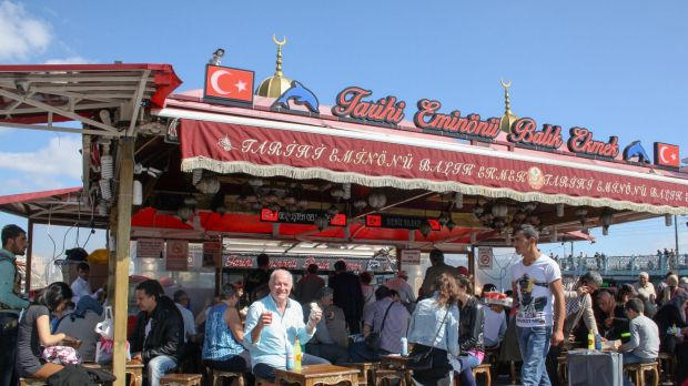 Rick Stein enjoys a Balik Ekmek (Istanbul's famous fish sandwich) by the shores of the Bosphorus, Istanbul, in Rick ...
