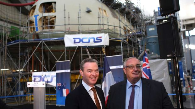 Minister for Defence Industry Christopher Pyne, and DCNS chief executive Herve Guillou, at the shipyards in Cherbourg, ...
