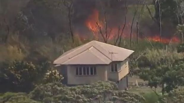 Houses are under threat from a large fire on Russell Island.