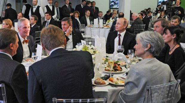 Briefly US national security advisor Michael Flynn sits next to Russian President Vladimir Putin at an event celebrating ...