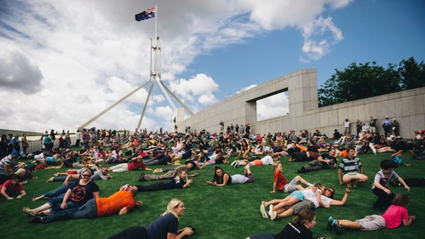 Hundreds rolled down the lawns of Parliament House to protest the current fence proposal