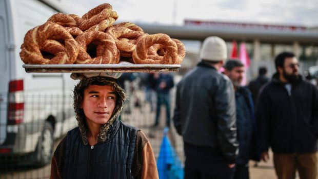 A vendor waits for customers at the Syria-Turkey border gate near Hatay in south-east Turkey.