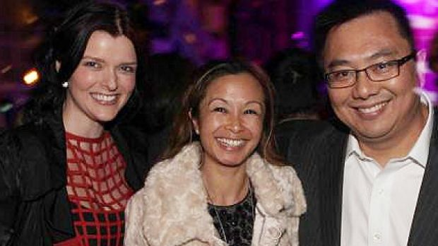 Amber Harrison, left, with former boss Nick Chan and his wife Peggy.