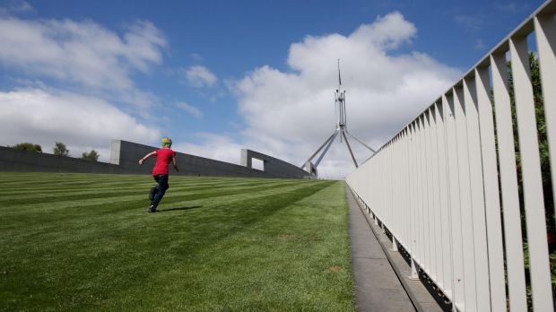 A new fence will cut across the lawns at the front of Parliament House.
