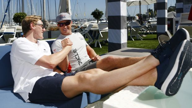 Kicking back: Olympic swimmer Mack Horton with James Spithill during promotions for the Sydney to Hobart.