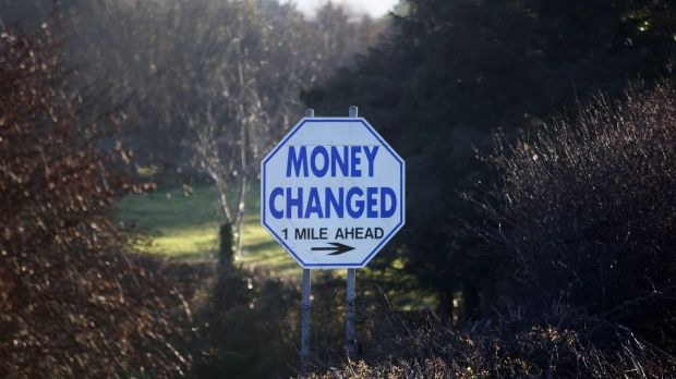 A sign advertising money exchange facilities stands on the roadside at the border between Northern Ireland and Ireland,.