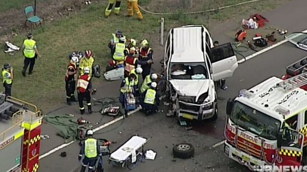 Emergency services at the scene of a head-on car crash in Luddenham.