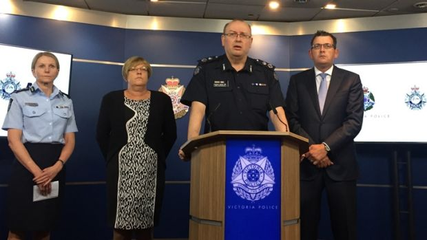 Chief Commissioner Graham Ashton with Premier Daniel Andrews, right, and Police Minister Lisa Neville, left.