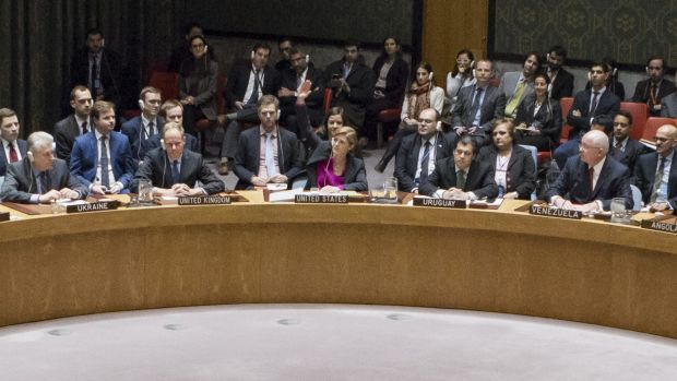 US ambassador to the UN Samantha Power, centre, raises her hand to abstain during the UN Security Council vote on 23 ...