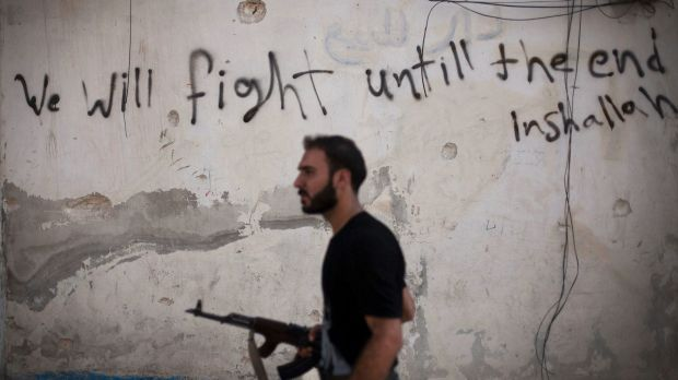 A Free Syrian Army soldier walks through a street in Amariya district in Aleppo in September. The rebels have now ...