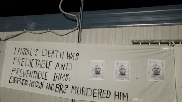 A sign at a memorial service for Faysal Ahmed on Manus Island.