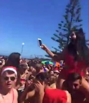 Revelers at Coogee Beach on Christmas Day.